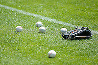Balls and a glove sit on the ground prior to the start of the game as the Salt Lake Bees faced the Fresno Grizzlies in Pacific Coast League action at Smith's Ballpark on June 14, 2015 in Salt Lake City, Utah.  (Stephen Smith/Four Seam Images)