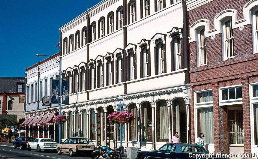 Victoria: 1117 Wharf St., The Rithet Bldg. (Tourism B.C.) The ground floor, 1888, although cast columns earlier--1861. 2nd & 3rd floors, later.  Photo '88.