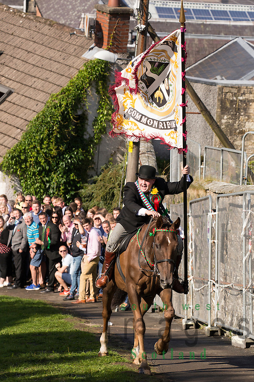 Langholm Common Riding 2016, Cornet Simon Tweddle holding the towns standard charges up on his horse Kirk Wynd