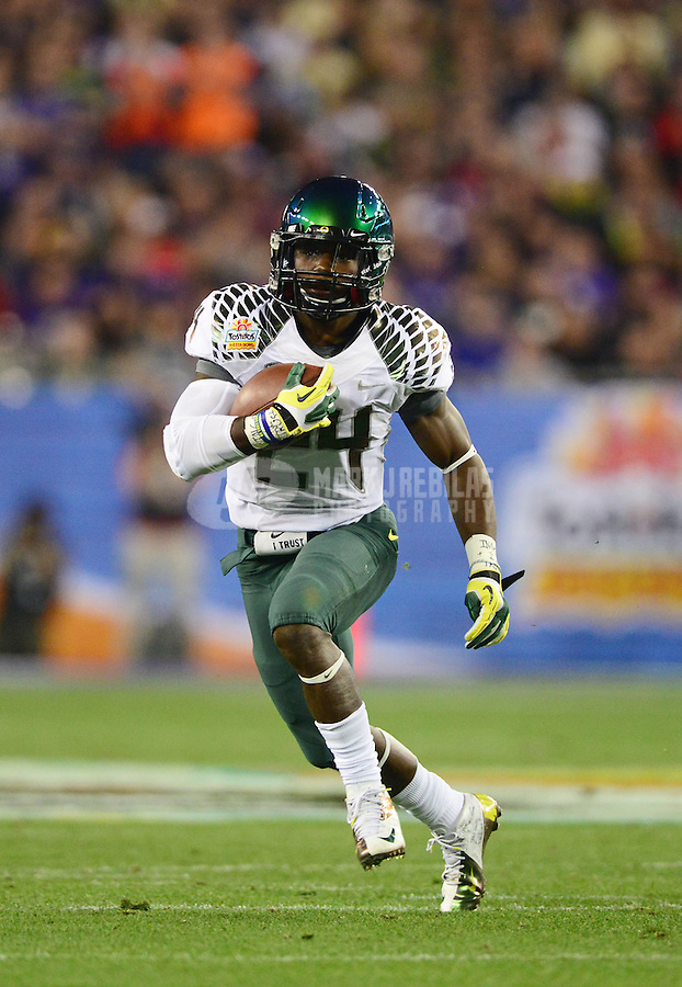 Jan. 3, 2013; Glendale, AZ, USA: Oregon Ducks running back Kenjon Barner (24) against the Kansas State Wildcats during the 2013 Fiesta Bowl at University of Phoenix Stadium. Oregon defeated Kansas State 35-17. Mandatory Credit: Mark J. Rebilas-