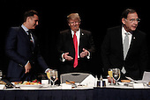 United States President Donald Trump (C) arrives at the National Prayer Breakfast February 2, 2017 in Washington, DC. Every U.S. president since Dwight Eisenhower has addressed the annual event. Also pictured (L-R) are television producer Mark Burnett, and Sen. John Boozman (R-AR).  <br /> Credit: Win McNamee / Pool via CNP