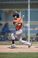 Baltimore Orioles Tanner Kirk (12) follows through on a swing during a minor league Spring Training game against the Tampa Bay Rays on March 29, 2017 at the Buck O'Neil Baseball Complex in Sarasota, Florida.  (Mike Janes/Four Seam Images)