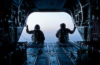 """Riding the """"Lighting Express,"""" via a Chinook on a ring route from Baghdad to Al Kut, Iraq just after sunset on Valentine's Day, February 14, 2011."""
