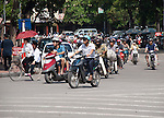 Hanoi, Vietnam, Motorcycles dominate the city streets as the most popular mode of transportatrion. photo taken July 2008.