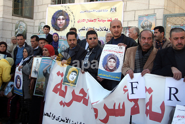 Families of Palestinians prisoners, held in Israeli jails, holding the pictures, of Hana Shalabi 30, from the militant Islamic Jehad movement in front of the International Committee of the Red Cross, (ICRC) offices in the West Bank town of Ramallah, 06 March 2012. Hana is on her 20th day of hunger strike because of her administrative detention, Hana, was released from prison on October 2011 during the prisoner exchange between Israel and Hamas.  Photo by Issam Rimawi