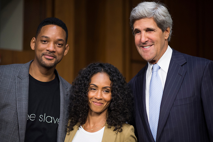 "UNITED STATES - JULY 16: From left, actor Will Smith, his wife Jada Pinkett Smith and chairman John Kerry, D-Mass., arrive for the Senate Foreign Relations Committee hearing on ""The Next Ten Years in the Fight Against Human Trafficking: Attacking the Problem with the Right Tools"" on Tuesday, July 17, 2012. Jada Pinkett Smith, advocate for Don't Sell Bodies, testified during the hearing while Will Smith listened form the audience. (Photo By Bill Clark/CQ Roll Call)"
