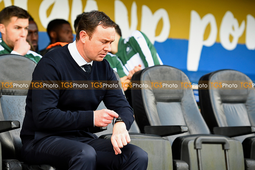 Plymouth Argyle Manager Derek Adams checks his watch before kick off during Portsmouth vs Plymouth Argyle, Sky Bet EFL League 2 Football at Fratton Park on 14th April 2017