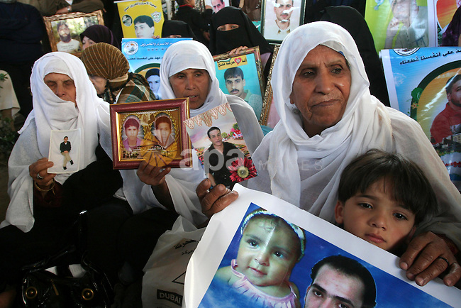 Palestinians hold pictures of jailed relatives during a protest in Gaza city calling for their release from Israeli prisons on April 11, 2011. Photo by Mohamad Asad