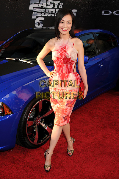 "Sarah Li.""Fast & Furious 6"" Los Angeles Premiere held at the Universal Gibson Amphitheatre, Universal City, California, USA..May 21st, 2013.full length white red pattern dress hand on hip.CAP/ADM/BP.©Byron Purvis/AdMedia/Capital Pictures"