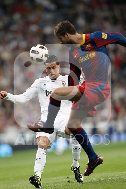 Real Madrid's Cristiano Ronaldo and FC Barcelona's Gerard Pique during la Liga match on April 16th 2011...Photo: Cesar Cebolla / ALFAQUI