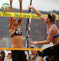 Germany's Helke Classen beats Anna Scarlet at the net during the 2009 McEntee Hire NZ Beach Volleyball Tour - Women's final at Oriental Parade, Wellington, New Zealand on Sunday, 11 January 2009. Photo: Dave Lintott / lintottphoto.co.nz.
