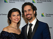 Alex Lacamoire and and his wife, Illeana Ferreras, arrive for the formal Artist's Dinner honoring the recipients of the 41st Annual Kennedy Center Honors hosted by United States Deputy Secretary of State John J. Sullivan at the US Department of State in Washington, D.C. on Saturday, December 1, 2018. The 2018 honorees are: singer and actress Cher; composer and pianist Philip Glass; Country music entertainer Reba McEntire; and jazz saxophonist and composer Wayne Shorter. This year, the co-creators of Hamilton­ writer and actor Lin-Manuel Miranda, director Thomas Kail, choreographer Andy Blankenbuehler, and music director Alex Lacamoire will receive a unique Kennedy Center Honors as trailblazing creators of a transformative work that defies category.<br /> Credit: Ron Sachs / Pool via CNP