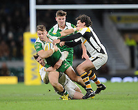 Alex Lewington of London Irish is tackled by Elliot Daly and Ben Jacobs of Wasps during the Premiership Rugby match between London Irish and Wasps - 28/11/2015 - Twickenham Stadium, London<br /> Mandatory Credit: Rob Munro/Stewart Communications