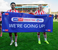 Lincoln City's Bruno Andrade, left, and Lincoln City's Danny Rowe celebrate after securing promotion from Sky Bet League Two<br /> <br /> Photographer Chris Vaughan/CameraSport<br /> <br /> The EFL Sky Bet League Two - Lincoln City v Cheltenham Town - Saturday 13th April 2019 - Sincil Bank - Lincoln<br /> <br /> World Copyright © 2019 CameraSport. All rights reserved. 43 Linden Ave. Countesthorpe. Leicester. England. LE8 5PG - Tel: +44 (0) 116 277 4147 - admin@camerasport.com - www.camerasport.com