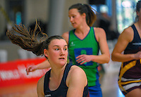 Action from the 2015 National Netball Championship match between Thames Valley (blue and green) and Southland (maroon and gold) at ASB Sports Centre, Kilbirnie, Wellington, New Zealand on Tuesday, 29 September 2015. Photo: Dave Lintott / lintottphoto.co.nz