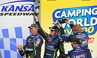 Sept. 28, 2008; Kansas City, KS, USA; Nascar Sprint Cup Series driver Jimmie Johnson (center) dumps champagne on the head of crew chief Chad Knaus (left) after winning the Camping World RV 400 at Kansas Speedway. Mandatory Credit: Mark J. Rebilas-