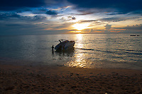Speedboat near Phuket beach in the sunset, Thailand