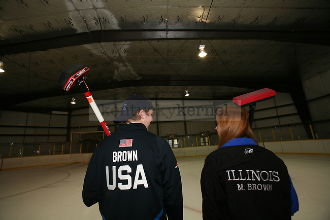 Curling score portrait. Photo by Adam Wolffbrandt | Staff