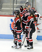 Maggie DiMasi (Northeastern - 4), Florence Schelling (Northeastern - 41), Katie MacSorley (Northeastern - 3) - The Boston University Terriers defeated the visiting Northeastern University Huskies 3-2 on Saturday, January 28, 2012, at Agganis Arena in Boston, Massachusetts.