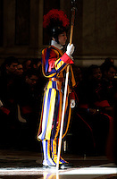 Una guardia svizzera adempie il suo compito mentre Papa Francesco celebra la Messa dell'Epifania nella Basilica di San Pietro, Citt&agrave; del Vaticano, 6 gennaio 2017.<br /> A Swiss guard stands as Pope Francis celebrates the Epiphany Mass in Saint Peter's Basilica at the Vatican, on January 6 2017.<br /> UPDATE IMAGES PRESS/Isabella Bonotto<br /> <br /> STRICTLY ONLY FOR EDITORIAL USE