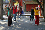 Asia, China, Beijing. Women exercising in the park at the Summer Palace.