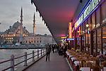 Istanbul, Turkey, Galata Bridge, Golden Horn, restaurants opening for dinner, Yeni Camii Mosque,