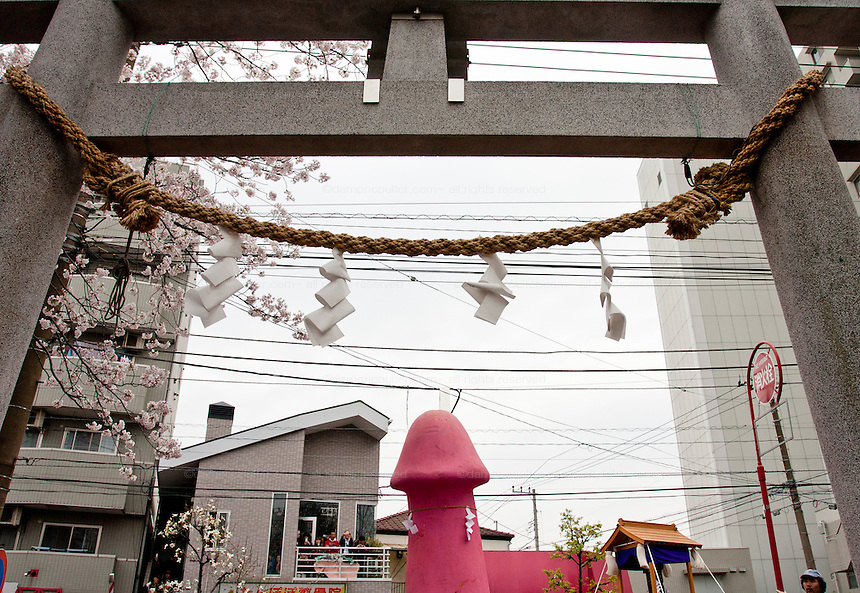 Transvestites from the Elizabeth club carry a mikoshi or portable shrine featuring a large pink phallus during the Kanamara matsuri, Kawasaki Daishi, Japan April 5th 2009