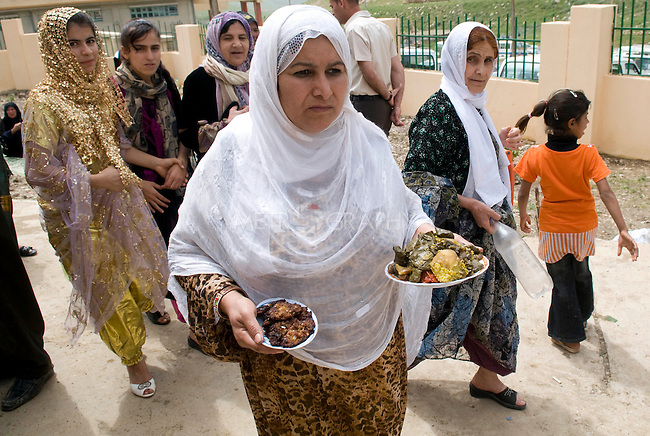 SULAIMANIYAH, IRAQ: Women prepare Dolma and Shifta, traditional Kurdish foods, for a picnic after the festival.  Friday April 30, 2010...This festival is an annual celebration for the followers of Sheikh Qadr Kesnazani, and was held later in the year to coincide with the birth of the prophet Mohammed, and allow for the the celebration to be held outside in Barzinji.  ..Photo by Aram Karim