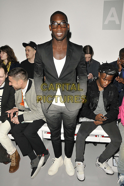 LONDON, ENGLAND - JANUARY 06: Tinie Tempah ( Patrick Chukwuemeka Okogwu ) attends the Astrid Anderson catwalk show, London Collections: Men's ( LCM ) a/w 2014 season, BFC Showspace, Victoria House, Bloomsbury Place, on Monday January 06, 2014 in London, England, UK.