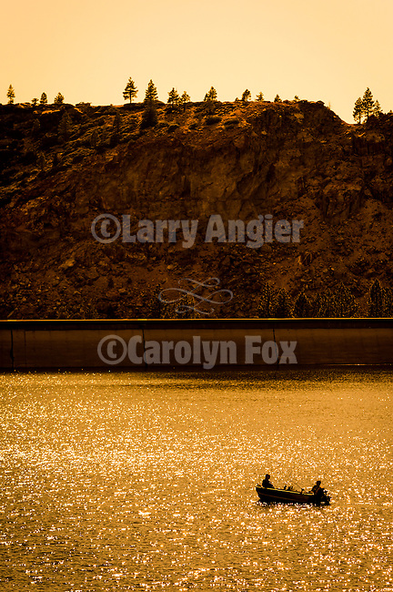 Fishing in the late afternoon in summer on Lower Bear River Reservoir in the El Dorado National Forest, Amador County, Calif.