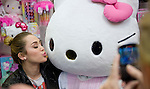 Miley Cyrus poses for a photo with the Hello Kitty mascot in the Sanrio Store in South Coast Plaza Friday night.  The singer/actress' foundation get Ur Good On, was at the shopping center as part of the Sharing the Spirit Holiday Party held for Orange County's shelter and motel kids..
