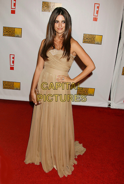 PENELOPE CRUZ.12th Annual Critics' Choice Awards held at the Santa Monica Civic Center, Santa Monica, California, LA, USA, 12 January 2007..full length gold dress clutch bag purse hand on hip.CAP/ADM/RE.©Russ Elliot/AdMedia/Capital Pictures.