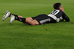 Paulo Dybala of Juventus lays on the turf after being upended by an opponent during the UEFA Champions League match at Juventus Stadium, Turin. Picture date: 26th November 2019. Picture credit should read: Jonathan Moscrop/Sportimage