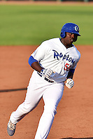 Justin Chigbogu (56) of the Ogden Raptors rounds the bases after hitting a home run against the Great Falls Voyagers on July 18, 2014 at Lindquist Field in Ogden, Utah. (Stephen Smith/Four Seam Images)