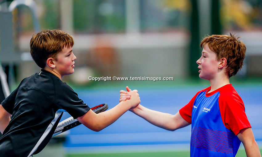 Hilversum, Netherlands, December 3, 2017, Winter Youth Circuit Masters, 12,14,and 16 years, Ties de Regt (NED) (L) is congratulated by Stefan Mos (NED)<br /> Photo: Tennisimages/Henk Koster