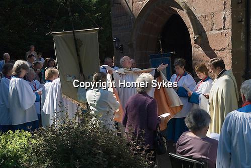 Church Clipping Ceremony St Peters Church, Edgmont, Shropshire Uk 2015.<br /> The Revd Prebendary Edward Ward.