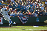 UCLA 3B Dean Espy throws late to first  in Game One of the NCAA Division One Men's College World Series Finals on June 28th, 2010 at Johnny Rosenblatt Stadium in Omaha, Nebraska.  (Photo by Andrew Woolley / Four Seam Images)