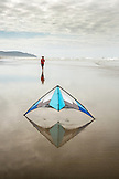 USA, Washington State, Long Beach Peninsula, man prepares to fly his kite at the International Kite Festival