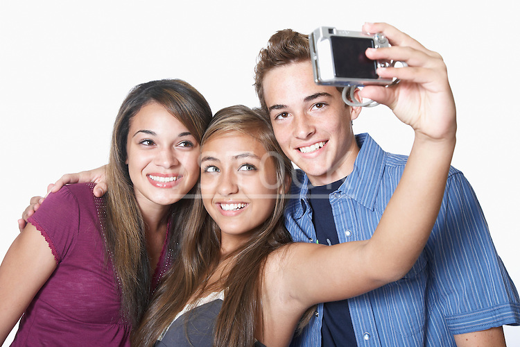 Three teenage friends photographing themselves