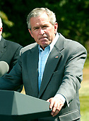 Camp David, MD - August 18, 2006 -- United States President George W. Bush holds a press availability after meeting with his economic advisors at Camp David, Maryland, Friday, August 18, 2006.<br /> Credit: Ron Sachs / Pool via CNP