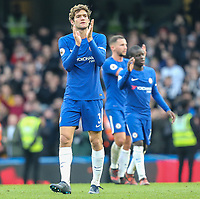 Marcos Alonso of Chelsea applauds the home supporters after the Premier League match between Chelsea and Newcastle United at Stamford Bridge, London, England on 2 December 2017. Photo by David Horn.