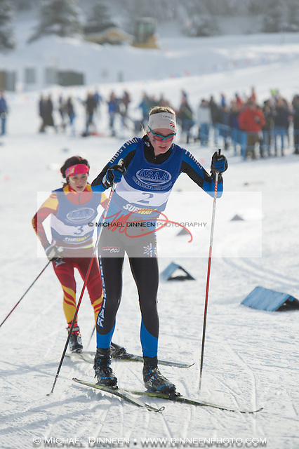 Chugiak's Emma Nelson leads a West Latrhop competitor on the way to the Mustang's second-place finish in the girl's mixed relay Saturday.  Photo by Michael DInneen for the Star.