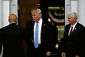 United States President-elect Donald Trump (C) and Vice President-elect Mike Pence (R) greet Peter Kirsanow (L) at the clubhouse of Trump International Golf Club, in Bedminster Township, New Jersey, USA, 20 November 2016.<br /> Credit: Peter Foley / Pool via CNP