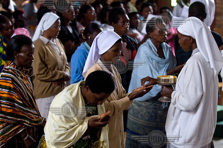 The congregation taking communion in the Notre Dame de la Sagesse Cathedral in Butare. It was built and named in memory of Belgium's Queen Astrid during the 1930s, when Butare served as Belgium's colonial capital and the town itself was called Astrida.