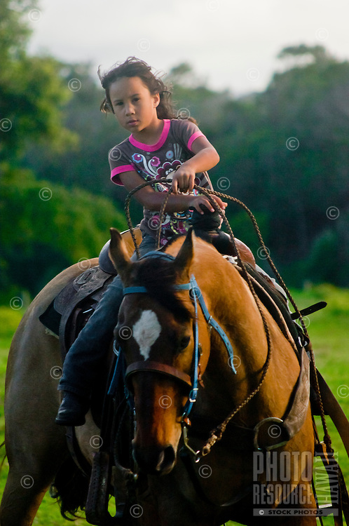 Young girl on horseback, Haiku, Maui