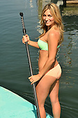 Young woman having fun on a paddle board
