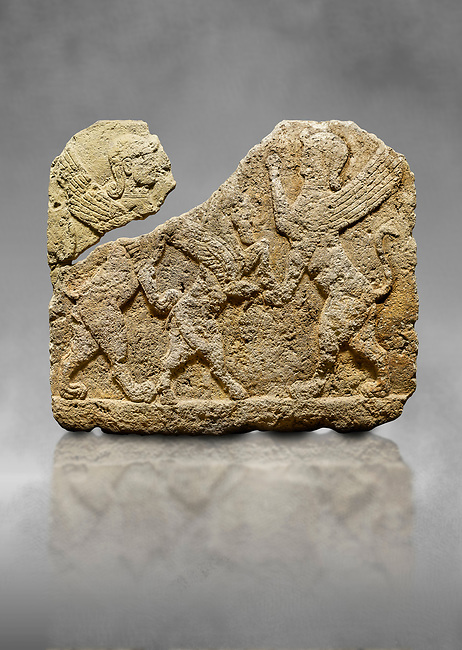Hittite relief sculpted orthostat stone panel of Herald's Wall Limestone, Karkamıs, (Kargamıs), Carchemish (Karkemish), 900-700 B.C. Anatolian Civilisations Museum, Ankara, Turkey.<br /> <br /> Two sphinxes standing on their hind legs on both sides attack to the winged horse standing on its hind legs in the middle.  <br /> <br /> Against a grey art background.