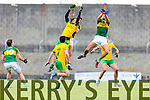 Jonathan Lyne and Anthony Maher Kerry in action against Martin McElhinney Donegal in Division One of the National Football League at Austin Stack Park Tralee on Sunday.