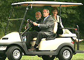 Camp David, MD - August 5, 2007 -- United States President George W. Bush gives President Hamid Karzai of Afghanistan a ride as first lady Laura Bush looks on from the backseat of a VIP golfcart at Camp David, Maryland on Sunday, August 5, 2007..Credit: Dennis Brack - Pool via CNP