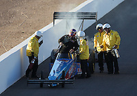 Feb. 22, 2013; Chandler, AZ, USA; NHRA top fuel dragster driver Mike Strasburg climbs from his car with the safety safari present during qualifying for the Arizona Nationals at Firebird International Raceway. Mandatory Credit: Mark J. Rebilas-